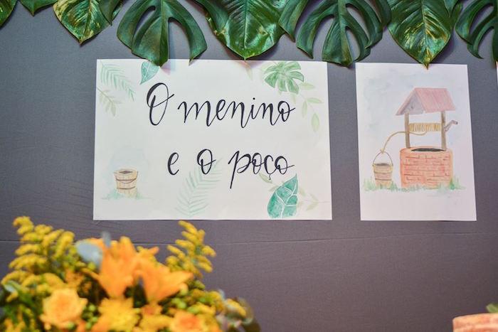 "Backdrop Signage from O Menino e o Poço ""The Boy and the Well"" 60th Birthday Party on Kara's Party Ideas | KarasPartyIdeas.com (20)"