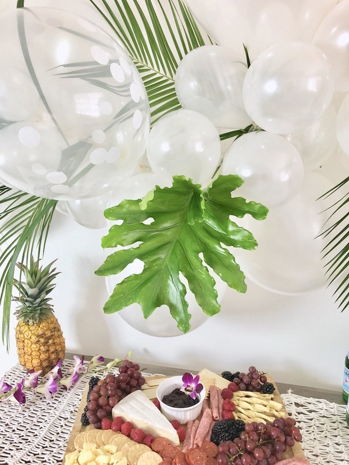 Tropical Leaf Balloon Installation from a Tropical Chic Charcuterie Table on Kara's Party Ideas | KarasPartyIdeas.com (6)