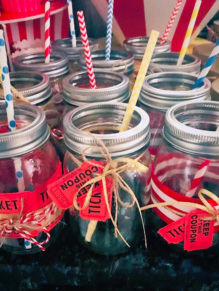 "Ticket-adorned Mason Jar Drink Cups from ""The Greatest Showman"" Circus Birthday Party on Kara's Party Ideas 
