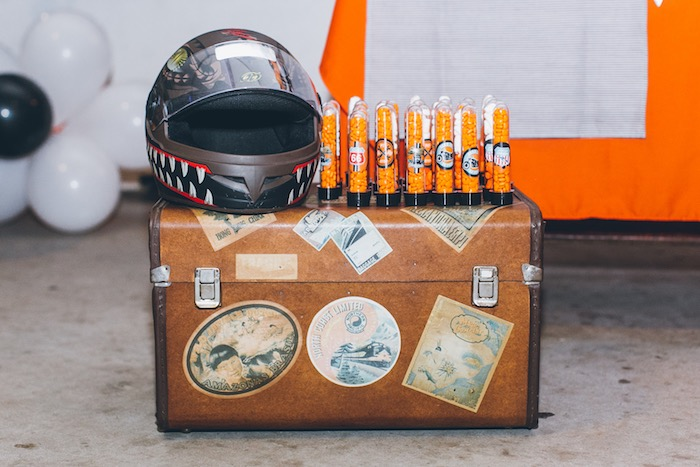 Helmet + Favor Tubes atop a Suitcase from a Harley Davidson Birthday Party on Kara's Party Ideas | KarasPartyIdeas.com (25)