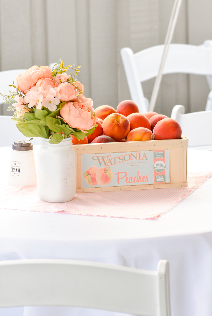 Table Centerpiece at a Sweet as a Peach Peaches and Cream 1st Birthday Party by Kara's Party Ideas