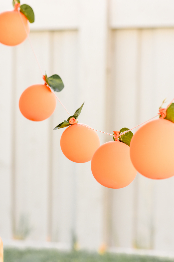 Peach Balloon Garland at a Sweet as a Peach Peaches and Cream 1st Birthday Party by Kara's Party Ideas