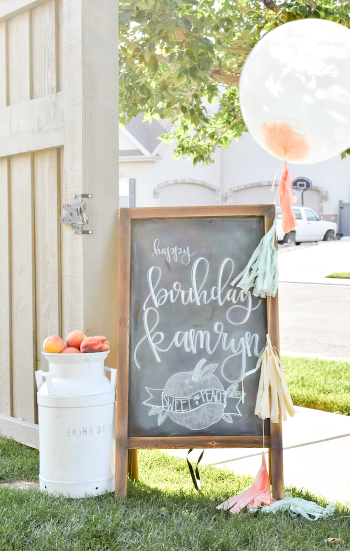 Chalk sign at a Sweet as a Peach Peaches and Cream 1st Birthday Party by Kara's Party Ideas