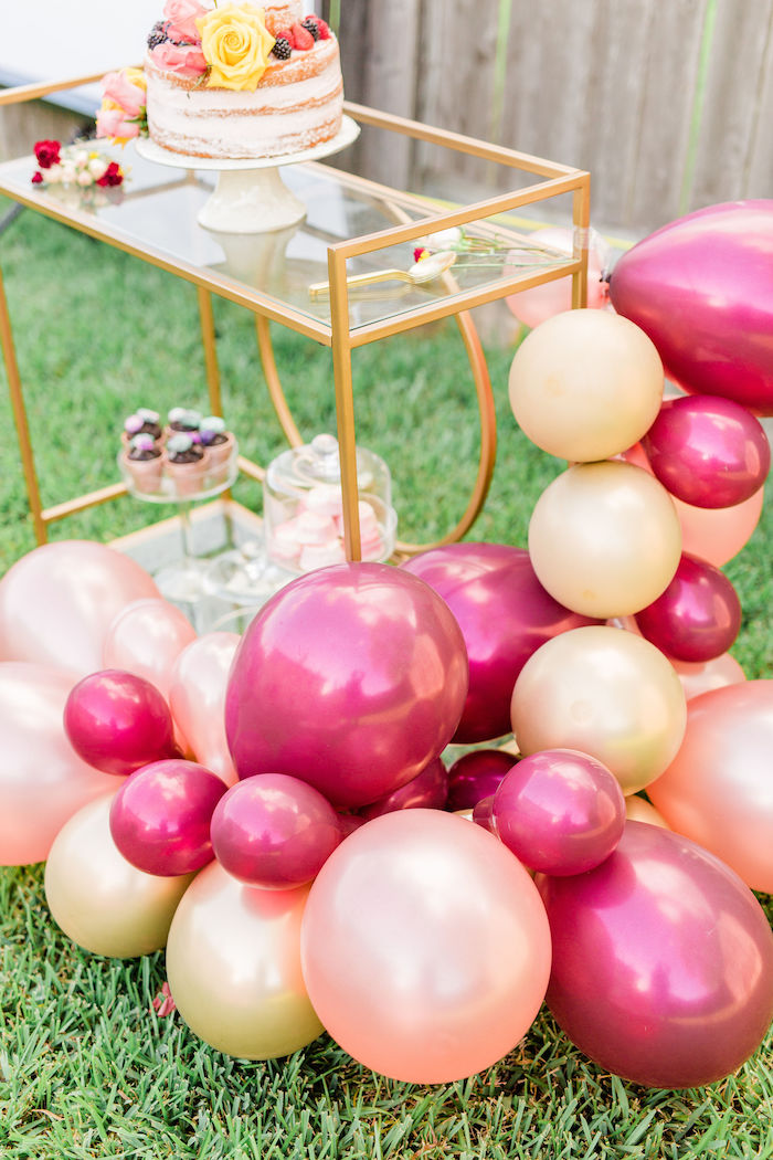 Balloon Garland installed on a Cake Cart from a Boho Chic Friendsgiving Party on Kara's Party Ideas | KarasPartyIdeas.com (14)