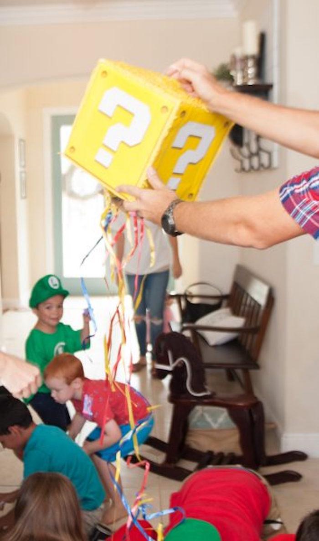 Question Block String Pinata from a DIY Super Mario Bros Birthday Party on Kara's Party Ideas | KarasPartyIdeas.com (5)