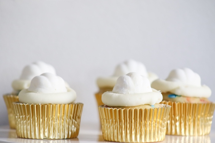 White-iced Cupcakes with Gold Foils from a Little Pumpkin 1st Birthday Party on Kara's Party Ideas | KarasPartyIdeas.com (12)