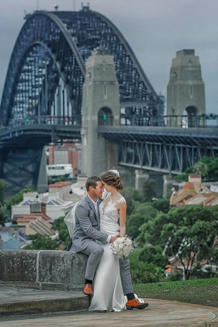 """Bride & Groom in front of Bridge from a """"Love at First Sight"""" Romantic Modern Wedding on Kara's Party Ideas 