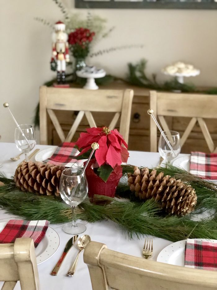 Pine Garland & Poinsettia Centerpiece from a DIY Plaid & Pine Classic Christmas Tablescape on Kara's Party Ideas | KarasPartyIdeas.com (10)
