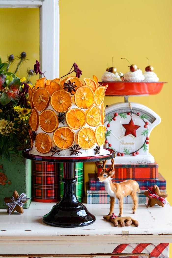 Red velvet cake decorated with dried orange slices and star anise from a Rustic Australian Christmas Dessert Table on Kara's Party Ideas | KarasPartyIdeas.com (18)