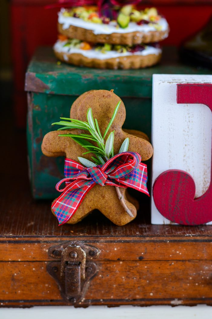Gingerbread Man Cookies tied with Tartan Ribbon from a Rustic Australian Christmas Dessert Table on Kara's Party Ideas | KarasPartyIdeas.com (37)