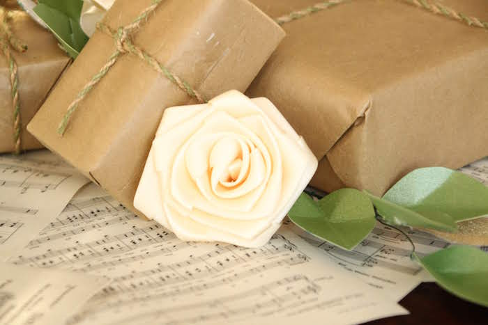 "Brown paper packages & ""Edelweiss"" Table Centerpiece from a Sound of Music Inspired 16th Birthday Party on Kara's Party Ideas 