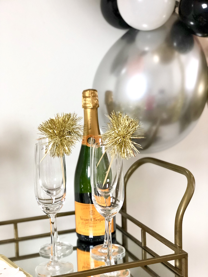 Wine Flutes with Gold Tinsel Pom Sticks from a New Year's Eve Drink & Dessert Station on Kara's Party Ideas | KarasPartyIdeas.com (4)