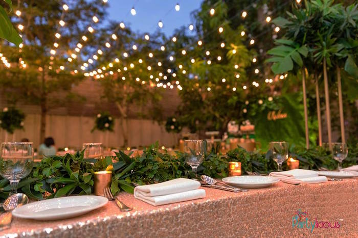 Blush Glam Guest Table lined with Greenery from a Glamorous Tropical Sweet 16 Birthday Party on Kara's Party Ideas | KarasPartyIdeas.com (22)