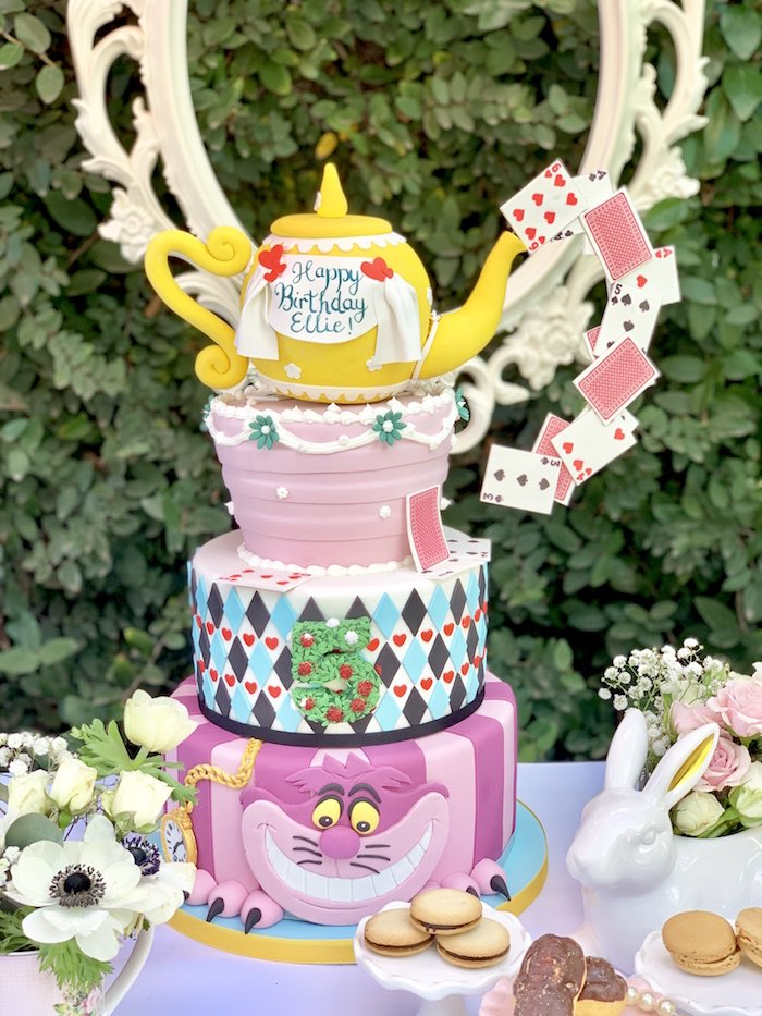 Alice in Wonderland Cake with pouring playing cards from an Alice in Wonderland Birthday Tea Party on Kara's Party Ideas | KarasPartyIdeas.com