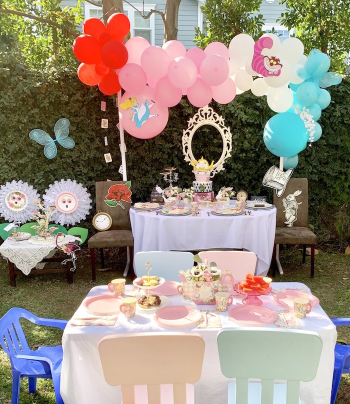 Alice in Wonderland Dessert Table with Talking Flowers from an Alice in Wonderland Birthday Tea Party on Kara's Party Ideas | KarasPartyIdeas.com