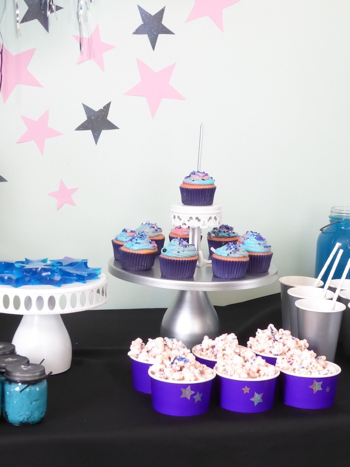 Galaxy popcorn and cupcakes from a Twinkling Star Galaxy Party on Kara's Party Ideas | KarasPartyIdeas.com