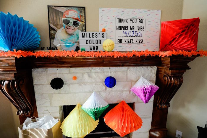 Tissue Pom Decorated Fireplace from a Holi Inspired Color War Birthday Party on Kara's Party Ideas | KarasPartyIdeas.com (7)