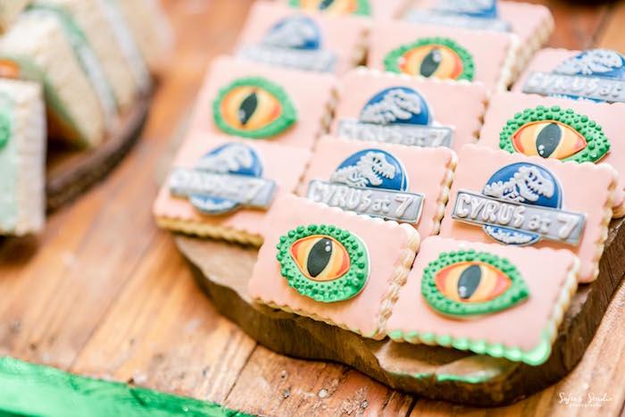 Dinosaur Eye + Jurassic World Logo Cookies from a Jurassic World Birthday Party on Kara's Party Ideas | KarasPartyIdeas.com (9)