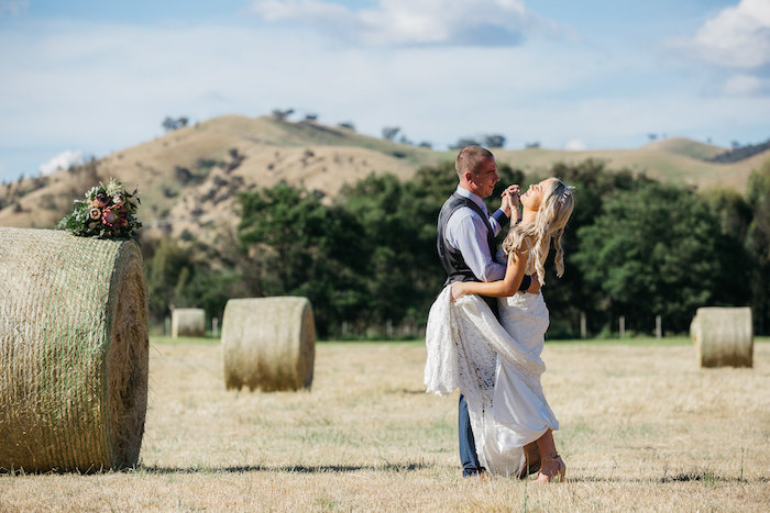 Bride & Groom in a Hayfield from a Country Boho Wedding on Kara's Party Ideas | KarasPartyIdeas.com (19)
