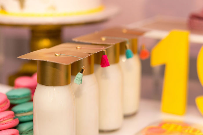 """Graduation-capped Milk bottles from a Glam Neon """"Oh the Places You'll Go"""" Graduation Party on Kara's Party Ideas 