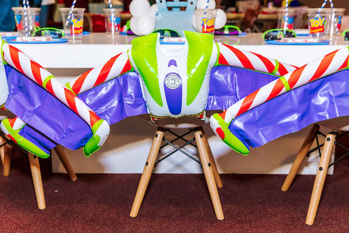 Chairs adorned with Inflatable Buzz Light Year Wings from a Toy Story Birthday Party on Kara's Party Ideas | KarasPartyIdeas.com (48)
