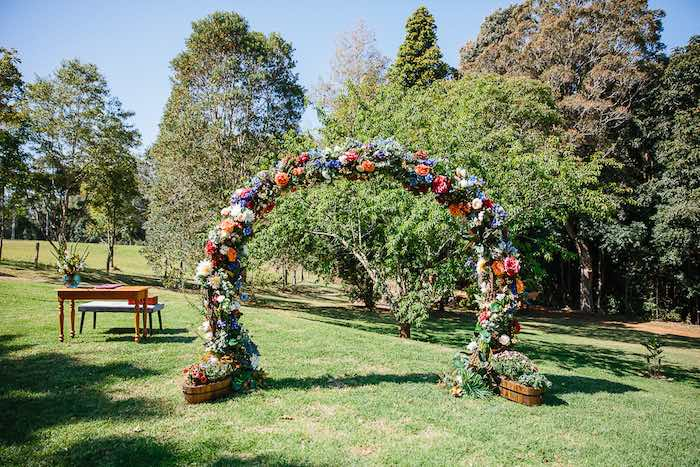Floral Wedding Arch from a Whimsical Festival Inspired Wedding on Kara's Party Ideas | KarasPartyIdeas.com (23)