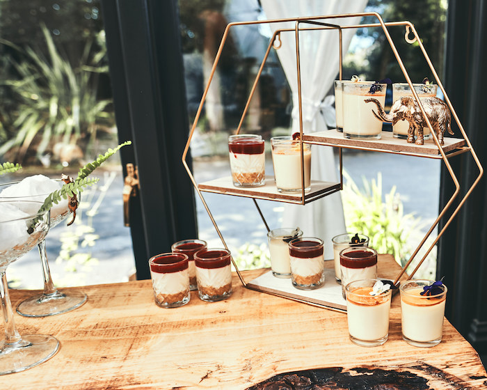 "Dessert Cups on a Modern Hexagon Dessert Shelf from a ""Welcome to the Wild"" Jungle Baby Shower on Kara's Party Ideas 