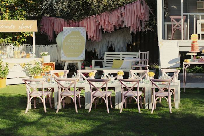 Guest Table lined with Pink Wood Chairs from a Vintage Chic Sunshine & Lemonade Party on Kara's Party Ideas | KarasPartyIdeas.com (14)