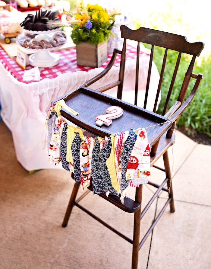 Highchair with Farm Themed Tassel Garland from a County Fair Inspired Farm Birthday Party on Kara's Party Ideas | KarasPartyIdeas.com (30)