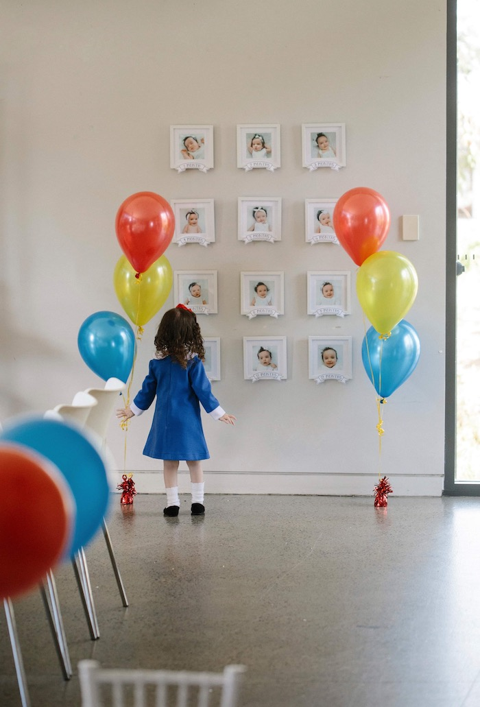 First Year Photo Display from a Madeline in Paris Inspired Birthday Party on Kara's Party Ideas | KarasPartyIdeas.com (15)