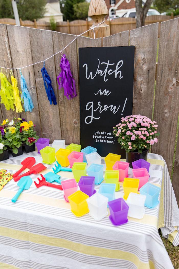 """Watch me grow"" plant favor table from a Somewhere Over the Rainbow Birthday Party on Kara's Party Ideas | KarasPartyIdeas.com (26)"