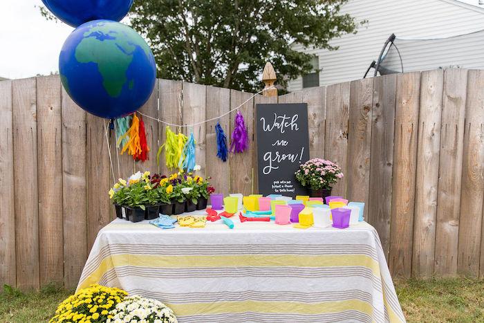 """Watch me grow"" - Plant Favor Table from a Somewhere Over the Rainbow Birthday Party on Kara's Party Ideas | KarasPartyIdeas.com (6)"