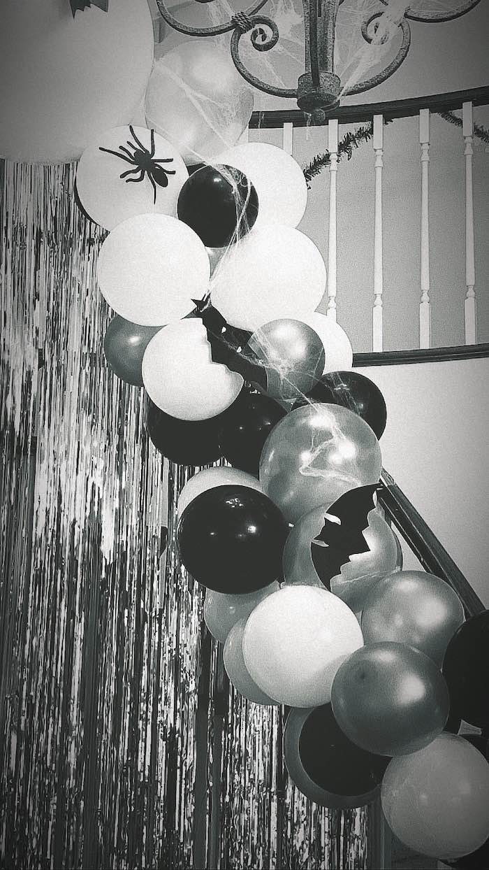 Black and white Halloween balloon garland from a Haunted Halloween Dinner Party on Kara's Party Ideas | KarasPartyIdeas.com