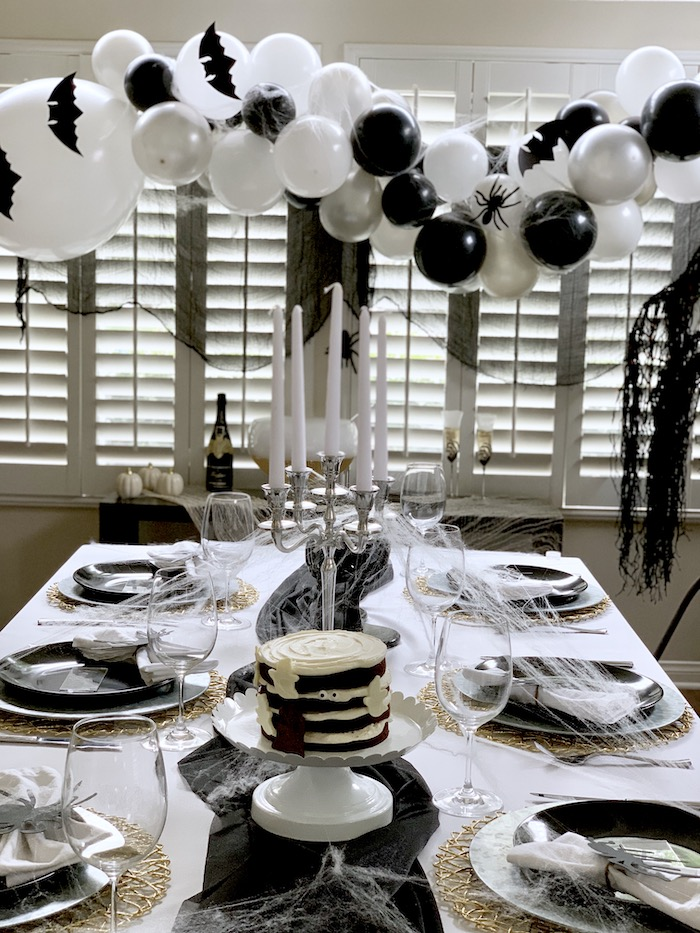 Monochromatic Halloween Table with Balloon Garland from a Haunted Halloween Dinner Party on Kara's Party Ideas | KarasPartyIdeas.com