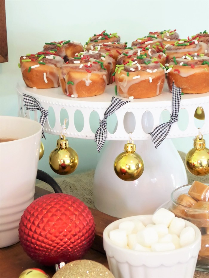 Cinnamon rolls on stand from a DIY Christmas Hot Cocoa Bar on Kara's Party Ideas | KarasPartyIdeas.com