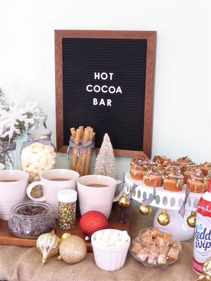Hot cocoa bar with cinnamon rolls from a DIY Christmas Hot Cocoa Bar on Kara's Party Ideas | KarasPartyIdeas.com