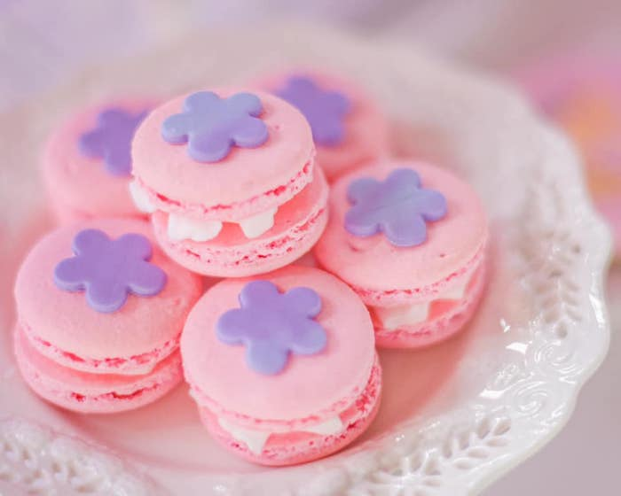 "Pink Macarons with Purple Flowers from an ""It's a Small World"" Birthday Party on Kara's Party Ideas 