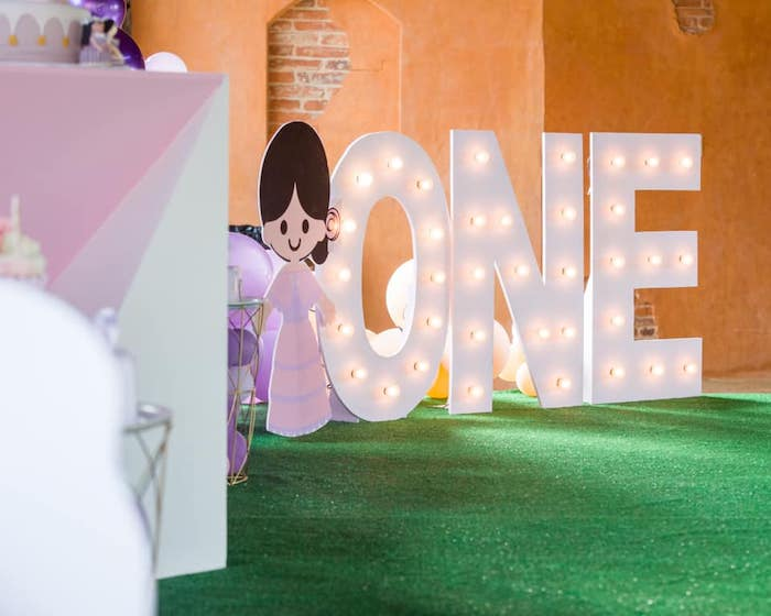 "ONE Marquee Letter Light from an ""It's a Small World"" Birthday Party on Kara's Party Ideas 