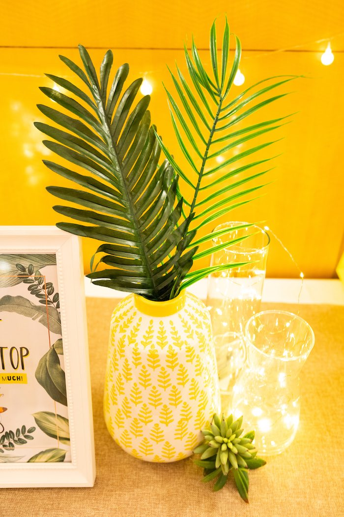 Yellow vase with tropical leaves + sparkles lit by a Boho Pokemon birthday party on Kara's party ideas KarasPartyIdeas.com (24)