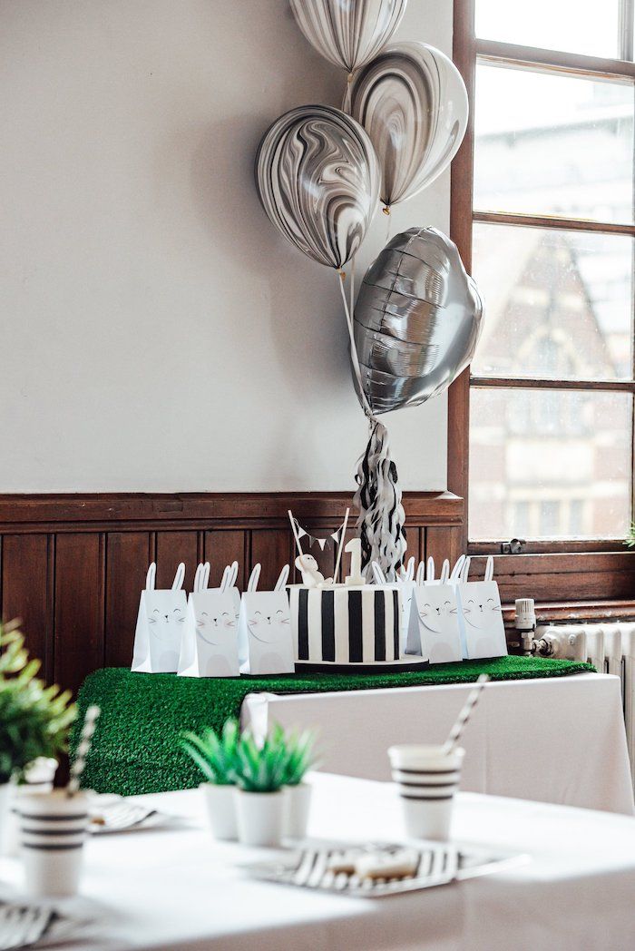"Cake + Favor Table from a Monochrome ""Some-Bunny is One"" Birthday Party on Kara's Party Ideas 