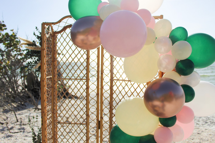 Balloon Garland attached to a Bamboo Screen from a Pink & Green Boho Beach Party on Kara's Party Ideas | KarasPartyIdeas.com (10)