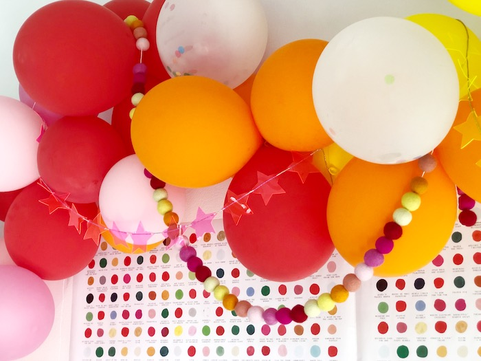 Rainbow Balloon + Felt Pom Ball Garland from a Rainbow Christmas Birthday Party on Kara's Party Ideas | KarasPartyIdeas.com (14)