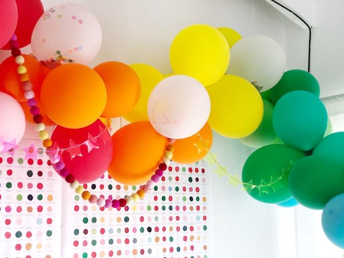 Rainbow Balloon + Felt Pom Ball Garland from a Rainbow Christmas Birthday Party on Kara's Party Ideas | KarasPartyIdeas.com (13)