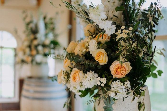 Orange & White Floral Arrangement from an Elegant Vineyard Wedding on Kara's Party Ideas | KarasPartyIdeas.com (13)