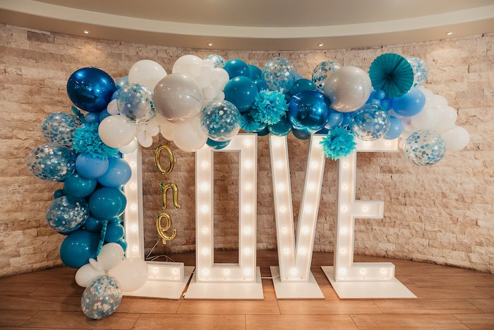 "LOVE Marquee Light Sign adorned with Balloon Garland from a Modern ""One Love"" Bob Marley Inspired Birthday Party on Kara's Party Ideas 