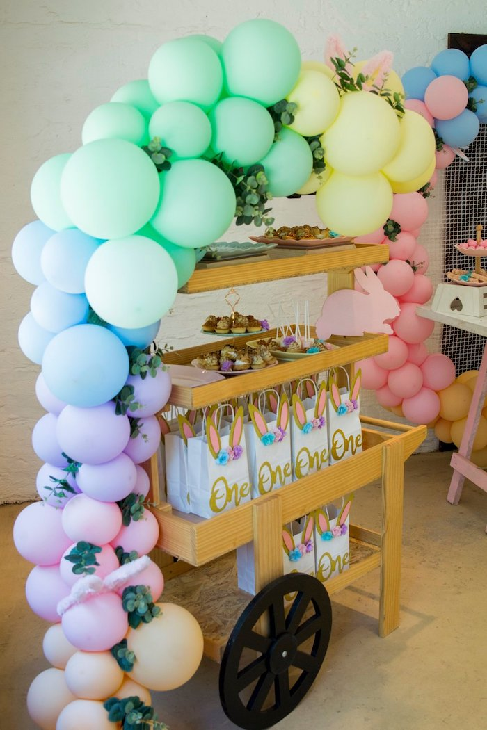 Pastel Balloon Arch atop a Dessert + Favor Cart from a Some Bunny is One Birthday Party on Kara's Party Ideas | KarasPartyIdeas.com (19)
