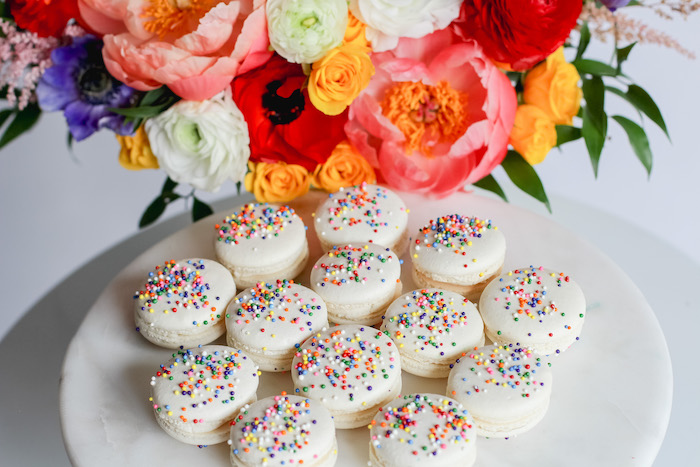"Sprinkled White Macarons from a ""Not All Heroes Wear Capes"" COVID-19 Essential Workers Tribute on Kara's Party Ideas 