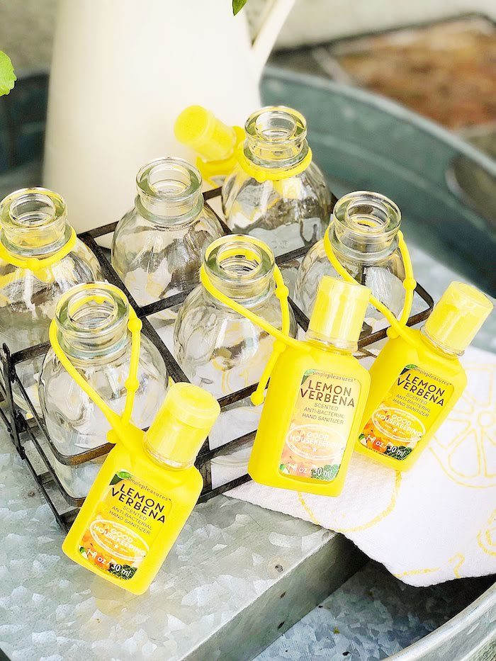 Lemon Verbena Hand Sanitizer Favors attached to Beverage Bottles from a Summer Lemon Baby Shower on Kara's Party Ideas | KarasPartyIdeas.com (27)