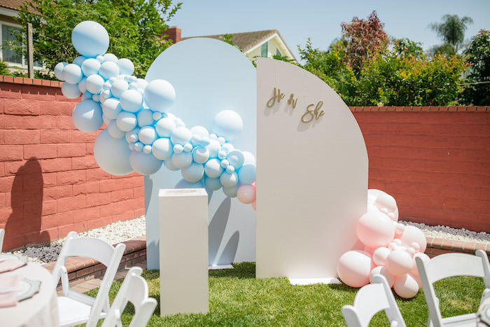 "He or She Balloon Install & Backdrop from a ""He or She? What Will the Baby Be?"" Gender Reveal on Kara's Party Ideas 
