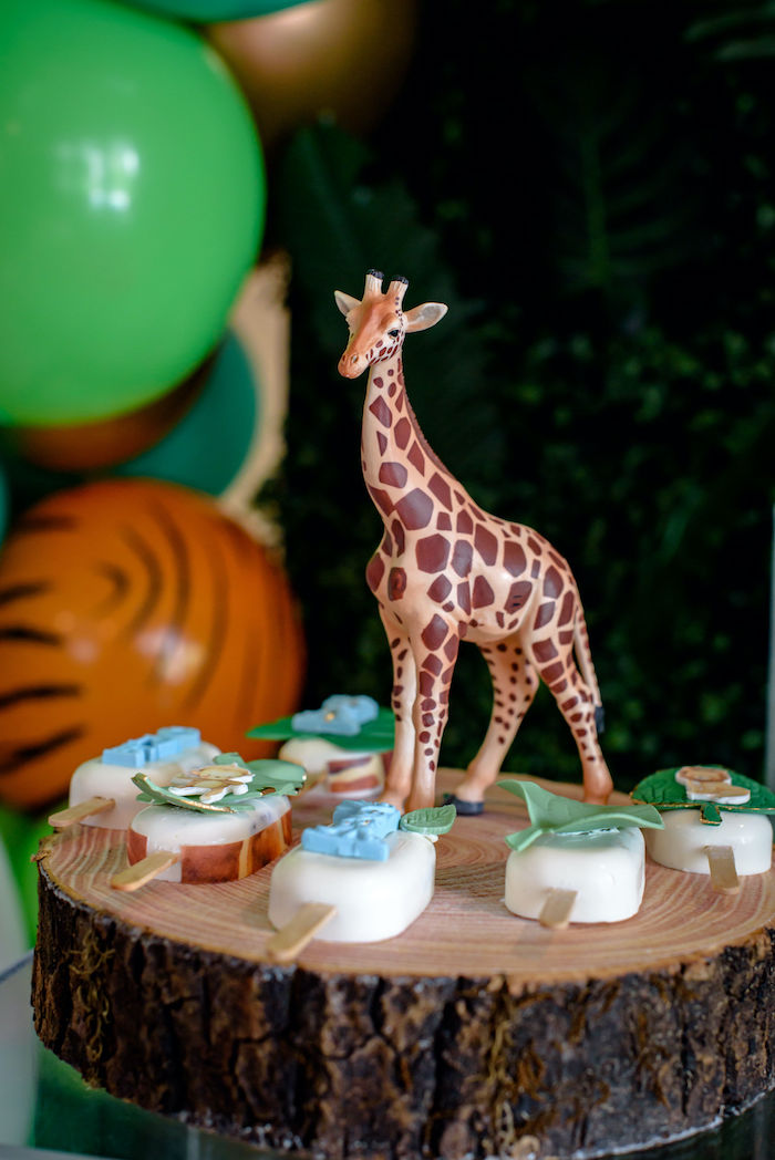 Giraffe-adorned Tree Stump Dessert Stand from a Wild One Safari Birthday Party on Kara's Party Ideas | KarasPartyIdeas.com (10)